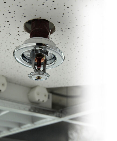 Installation process of a fire sprinkler in a ceiling - always ready for spraying water on a fire. Useful file for your brochure about security, safety and water piping systems.